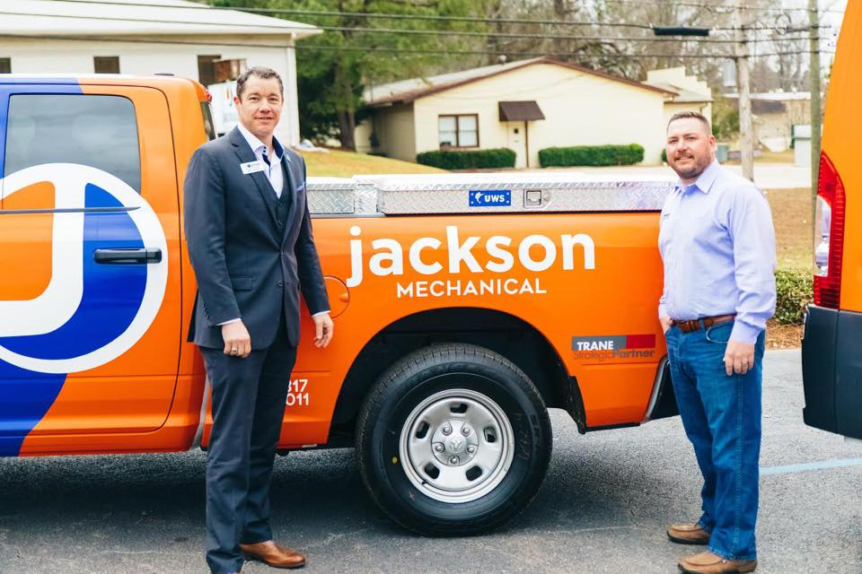 Dale Jackson and Ben McWhorter show off the work truck for the new mechanical division.