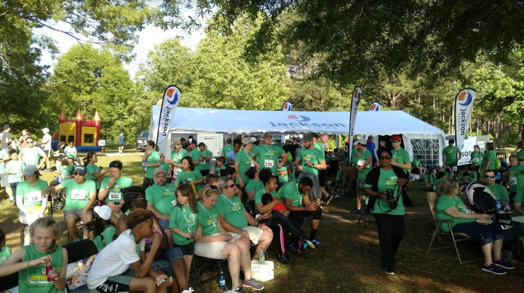 Numerous attendees enjoy Jackson Services' community tent at the Kia Road Race event