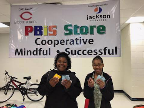Students at Callaway Middle School show off their Cavalier Bucks at the PBIS store